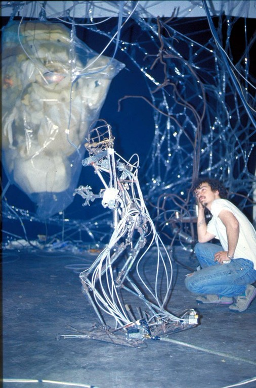Chico MacMurtrie in his installation