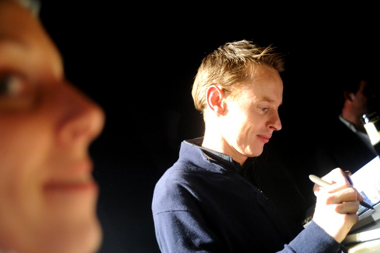 Daan Roosegaarde signing his publication