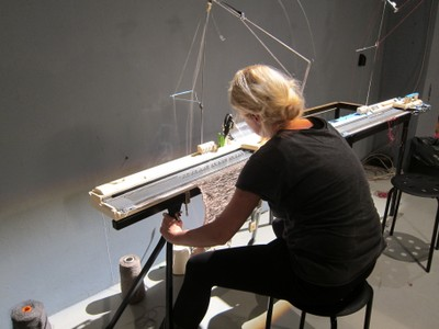 Participant with Knitting Machine